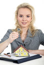 Woman holding a miniature house Royalty Free Stock Photo