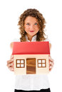 Woman holding model of house isolated on white background showing Stock Photography