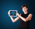 Woman holding modern tablet with colorful icons Royalty Free Stock Photos
