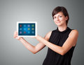 Woman holding modern tablet with colorful icons Royalty Free Stock Photography