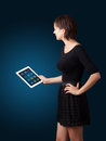 Woman holding modern tablet with colorful icons beautiful Royalty Free Stock Photos