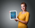 Woman holding modern tablet with colorful icons beautiful Royalty Free Stock Images