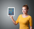 Woman holding modern tablet with colorful icons beautiful Stock Image