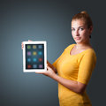 Woman holding modern tablet with colorful icons beautiful Stock Photo