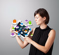 Woman holding modern tablet with colorful shopping bags on cloud Royalty Free Stock Photo
