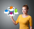 Woman holding modern tablet with colorful shopping bags on cloud beautiful clouds Stock Photography