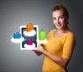 Woman holding modern tablet with colorful shopping bags on cloud beautiful clouds Stock Photos