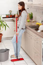Woman holding a mop Royalty Free Stock Photo