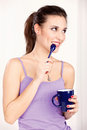 Woman holding morning coffee pretty cup of and spoon Royalty Free Stock Image