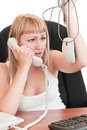 Woman holding a mouse and talking on the phone Stock Photography