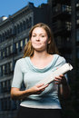 Woman holding newspaper Royalty Free Stock Photo