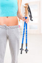 Woman holding nordic walking sticks female hands at her home Royalty Free Stock Photos