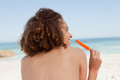 Woman holding an orange ice lolly Royalty Free Stock Photos