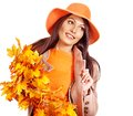 Woman holding  orange leaves. Royalty Free Stock Images