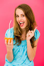 Woman holding orange with straw Royalty Free Stock Photos