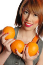 Woman holding oranges Royalty Free Stock Photography