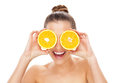 Woman holding oranges over eyes Stock Image