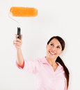 Woman holding a paint roller Stock Photography