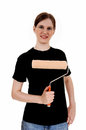 Woman holding paint roller a smiling in a black t shirt a on her chest isolated on white background Royalty Free Stock Image