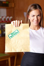 Woman holding paper bag in store Stock Image