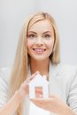 Woman holding paper house picture of young white Stock Photography