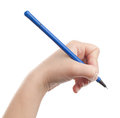 Woman holding a pen Royalty Free Stock Photos