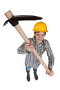 Woman holding pick axe Royalty Free Stock Image