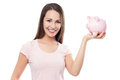 Woman holding piggy bank young over white background Stock Images