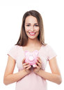 Woman holding piggy bank young over white background Royalty Free Stock Image