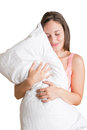 Woman holding pillow a white isolated in a white background Stock Image