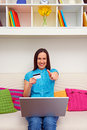 Woman holding plastic card and showing thumbs up Stock Photos