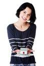 Woman holding polish zloty bills and house model Stock Image