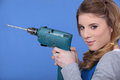Woman holding power drill Royalty Free Stock Photo