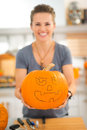 Woman holding pumpkin Jack-O-Lantern for Halloween. Closeup Royalty Free Stock Photo