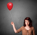 Woman holding a red balloon young drawing Stock Photos
