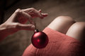 Woman holding a red Christmas globe Royalty Free Stock Photo