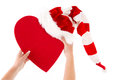 Woman holding red heart with santa hat and a heart for love in her hands Royalty Free Stock Photography