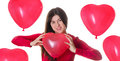 Woman  holding red heart shaped balloon Royalty Free Stock Photography