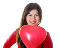 Woman  holding red heart shaped balloon Royalty Free Stock Photos