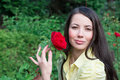 Woman holding a red rose with in the garden Stock Photo