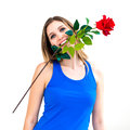 Woman holding red rose in her mouth young Royalty Free Stock Photography