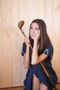 Woman holding retro golf stick Royalty Free Stock Images