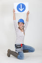 Woman holding road sign Royalty Free Stock Photos