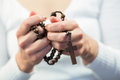 Woman holding rosary beads Royalty Free Stock Photo