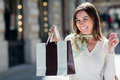 Woman holding a shopping bag Royalty Free Stock Images