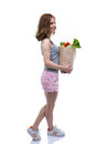 Woman holding a shopping bag full of groceries Royalty Free Stock Photo