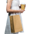 Woman holding a shopping bag young smiling and paper cup isolated on white background Royalty Free Stock Photography