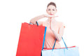 Woman holding shopping bags making time out gesture Royalty Free Stock Photo