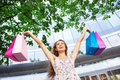 Woman holding shopping bags young with Stock Photography