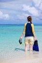 Woman holding snorkeling equipment Stock Photos